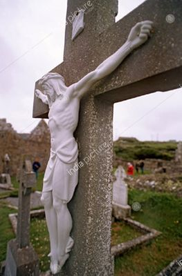 Grave stone with Jesus Christ on Cross, Seven Churches Cemetery, Inishmore, Ireland, Europe.