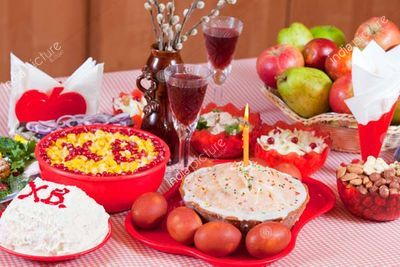 celebrate table with Easter cake and holiday meal